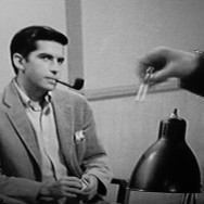 George Opts For a Pipe Under Interrogation